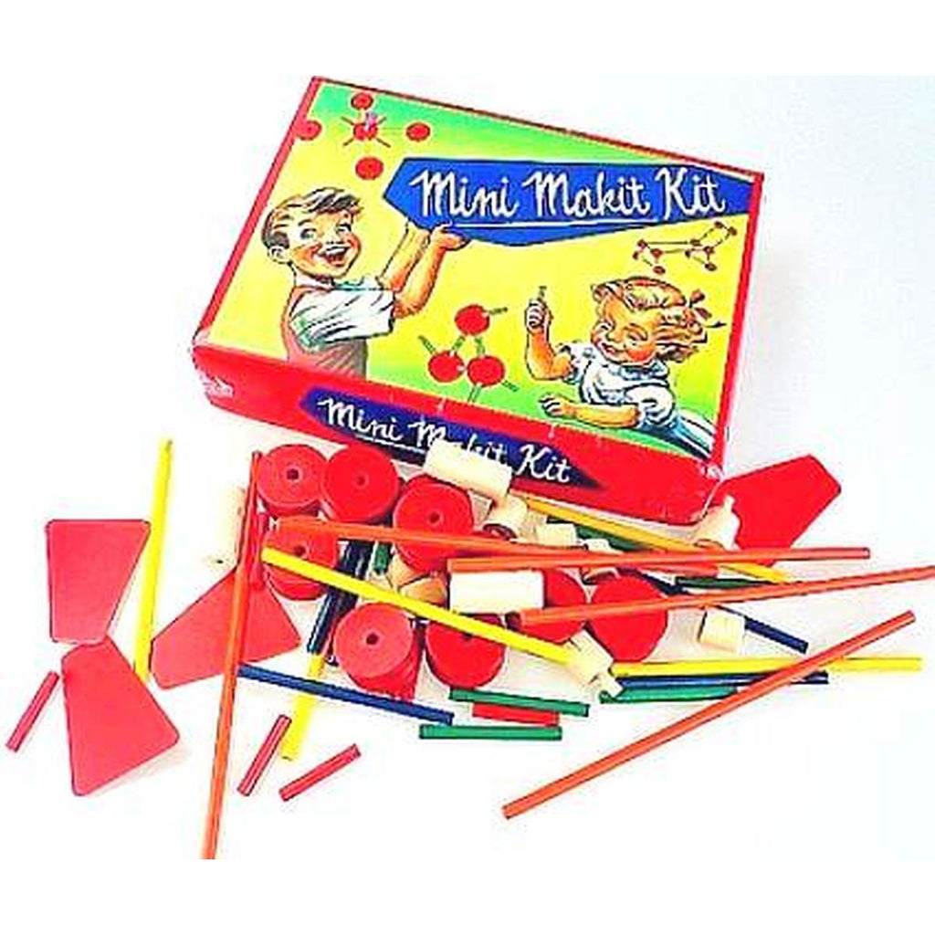 "A wooden construction set is pictured unboxed, featuring scattered rods, circles and other shapes in bright colours. Pictured next to the box with the text "" Mini Makit Kit"" on the front and a vintage illustration of playing children."