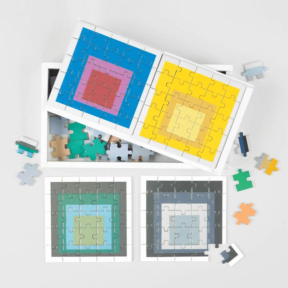 A boxed set of six wooden 25 piece puzzle bearing bright block colour artwork by Josef Albers.
