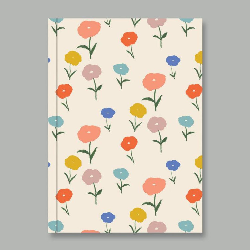 A5 notebook with a beige background with a graphic illustration of small rainbow flowers