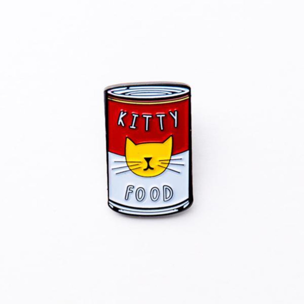 Image featuring an enamel pin in the center which has been designed to look like a pop art can by andy warhol - which includes a cat icon
