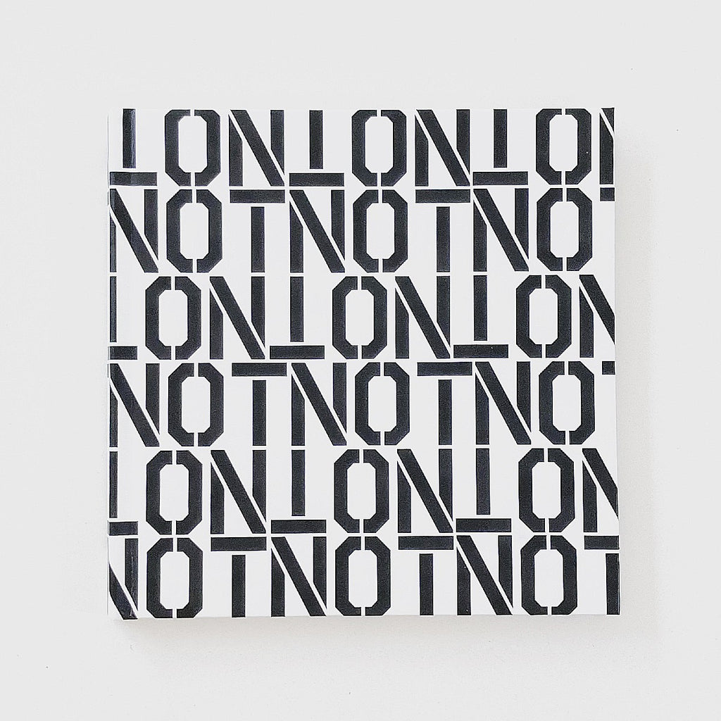 "The Cover of the Artists book NOTNOT: Digital Realities by Cam Scott. The cover features repeat block letter that spell ""NOT"" in black on a white background."