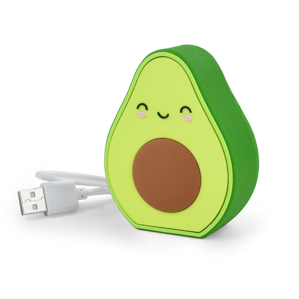 Image featuring in the center a Avocado power bank which features its usb chord next to it, on the face of the avocado it includes a smile, eyes and rosy cheeks
