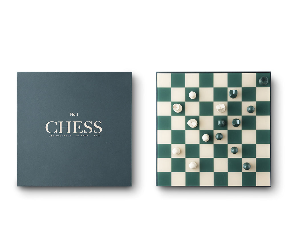 Image featuring a white background with a classically designed green and cream chess set including pieces and green packaging box