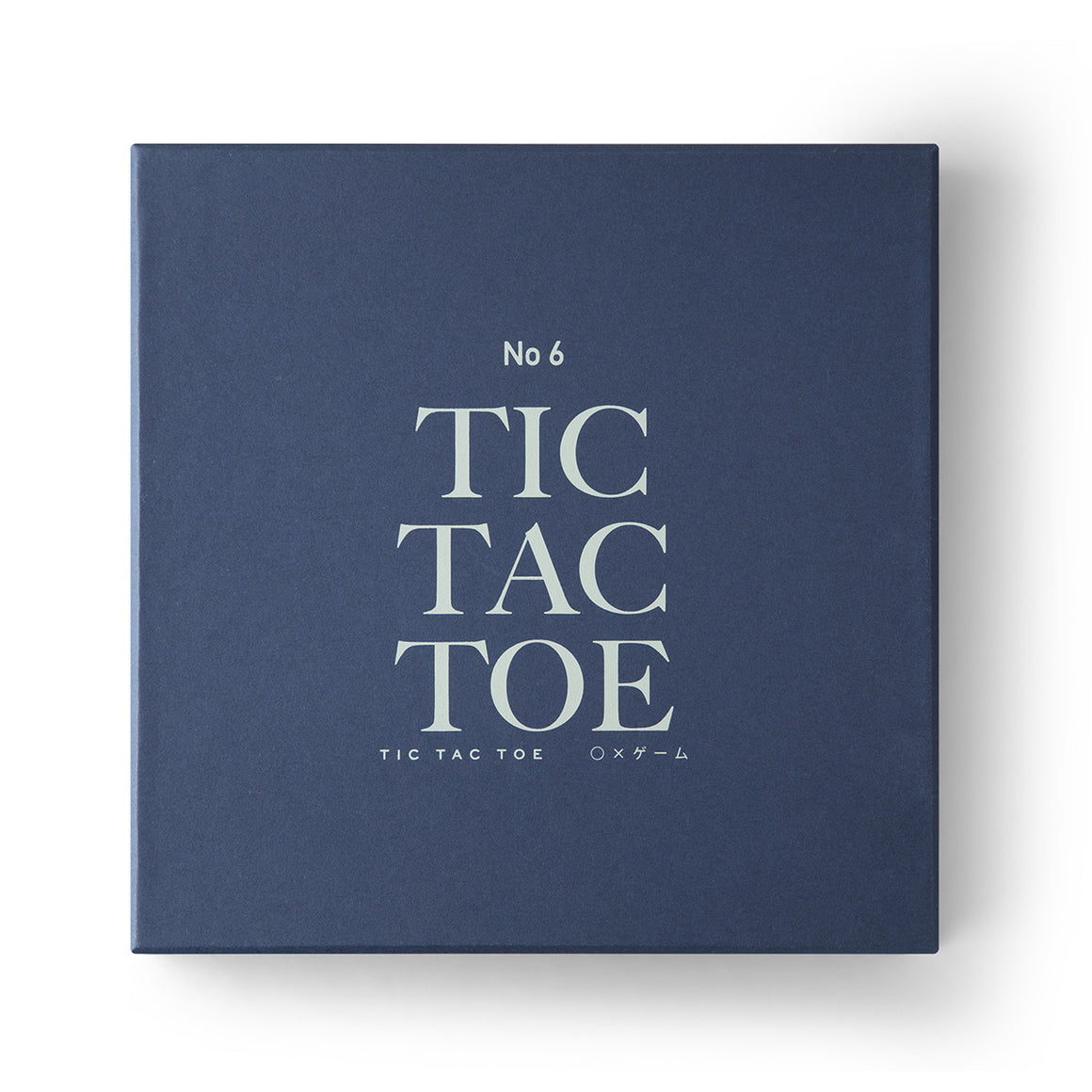 Image featuring a white background with a simplistic navy blue packaging box with the words No.6 Tic Tac Toe on the front
