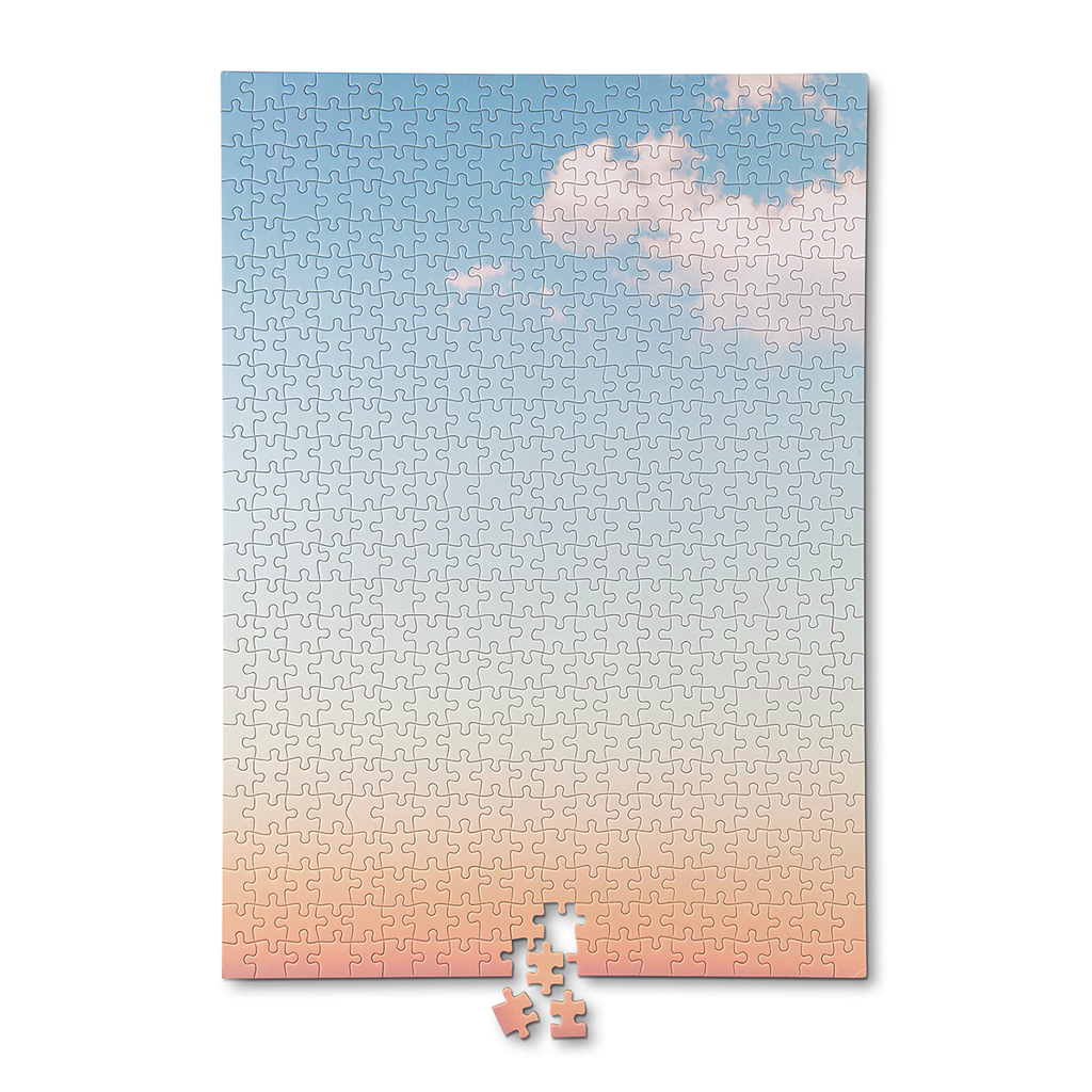 a 500 piece puzzle featuring a photo  of the subtly coloured dawn sky. The puzzle is shown completed.