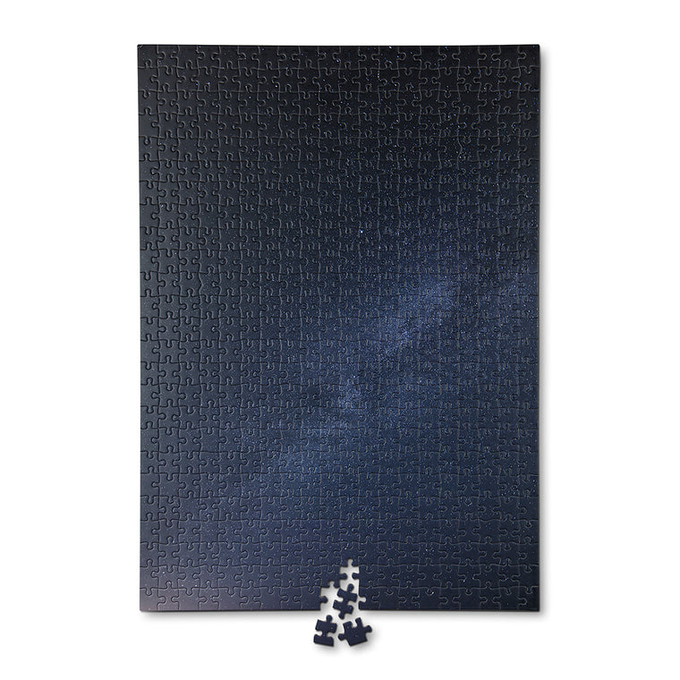a 500 piece puzzle featuring a photo of the night sky. A scattering of stars is featured on a dark and subtly coloured night sky. The puzzle is shown completed.