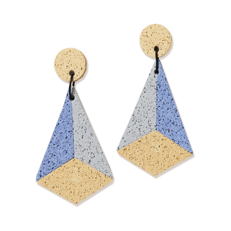 Image featuring two individual earrings which hold a rubberized texture which features the colours pastel yellow, pastel blue, grey  in a retro and art deco shape