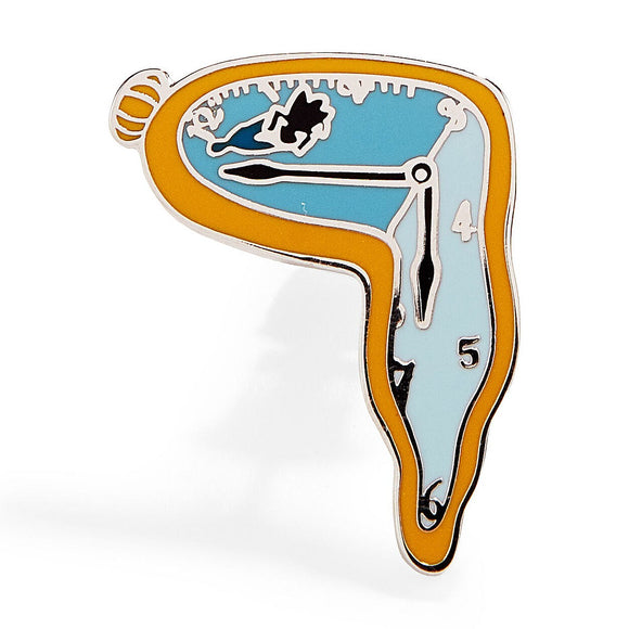 An enamel pin featuring the melting clock of Salvador Dali's 'The Persistence of Memory'