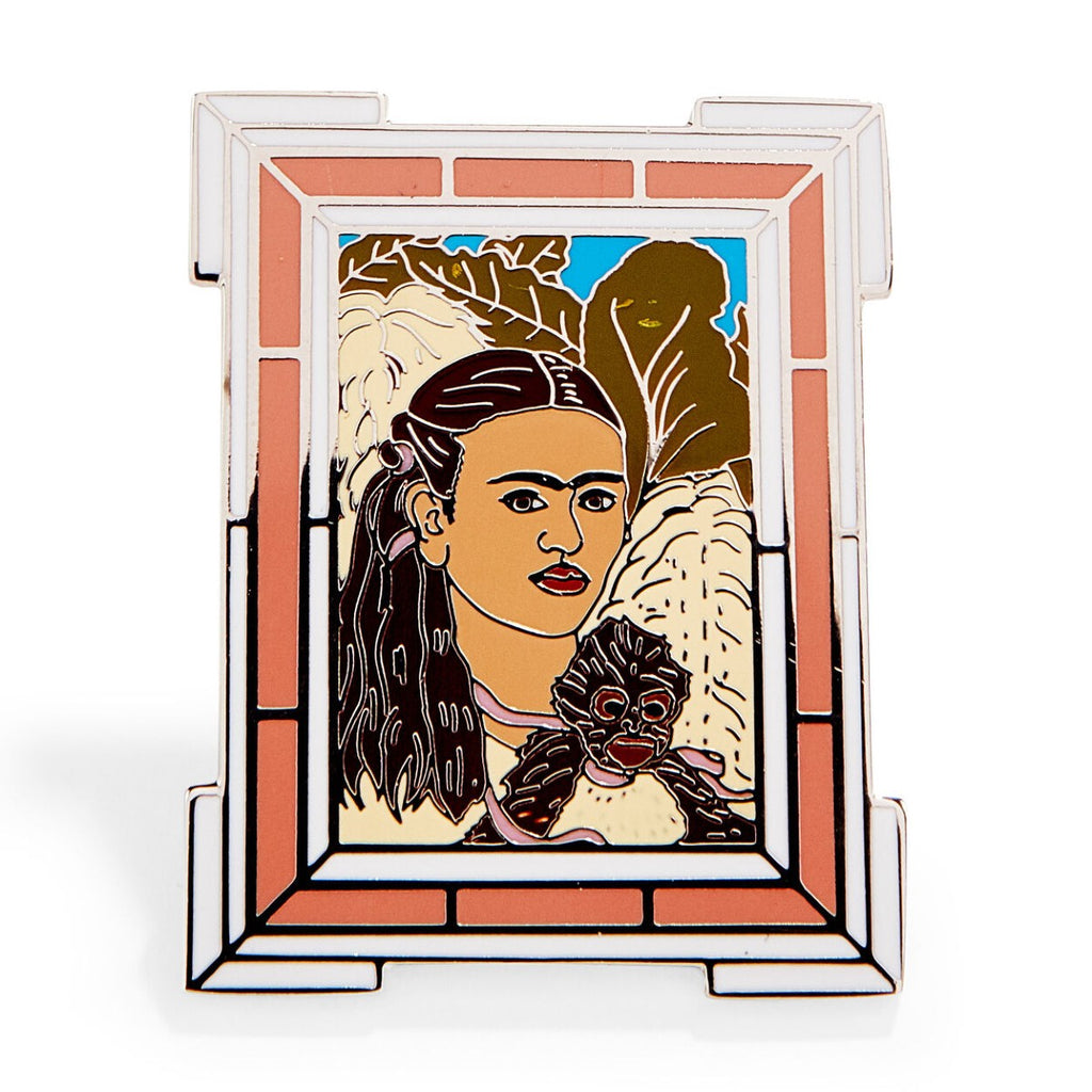 An enamel pin featuring a version of Frida Kahlo's 'Fulang-Chang and I'