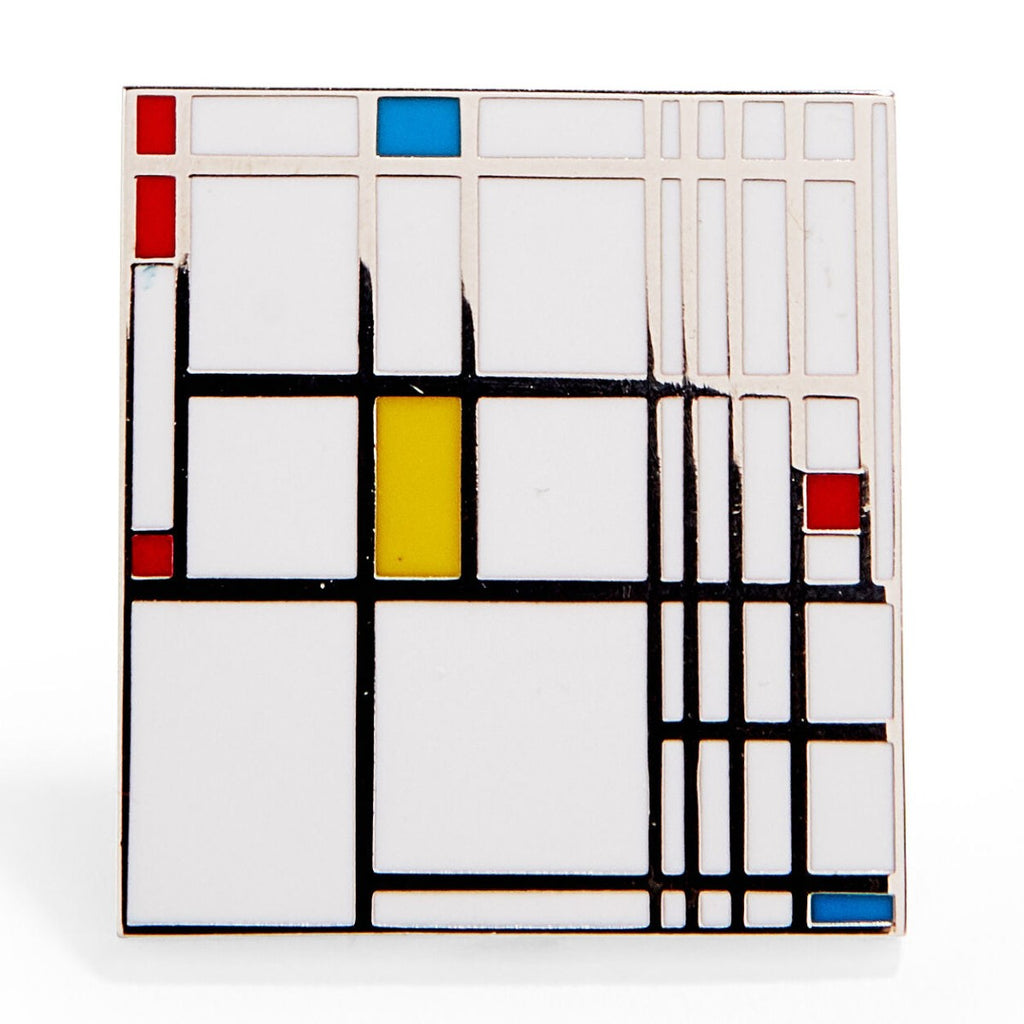 An enamel pin featuring a version of Piet Mondrian's 'The Composition""