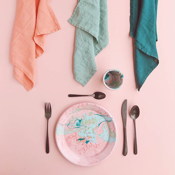 An enamel plate with beautiful marbled enamel in a range of contrasting tones of Turqouise and Green on a Blush Pink Base.