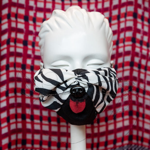 Mask featuring zebra print striped fabric including whiskers, pink fabric tongue and a black plastic dog nose