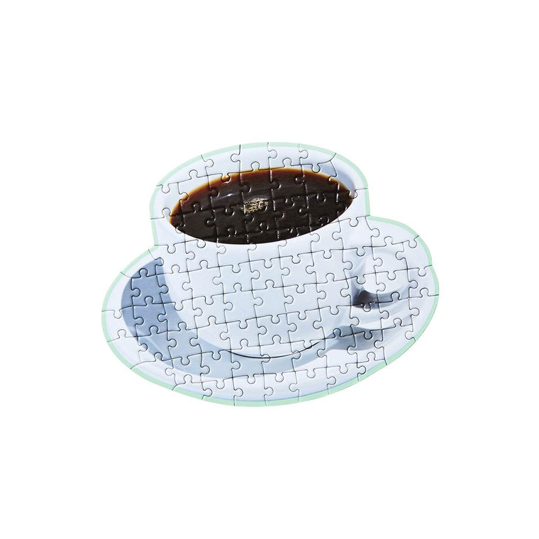 A cute puzzle in the shape and print of a cup of coffee on a saucer.