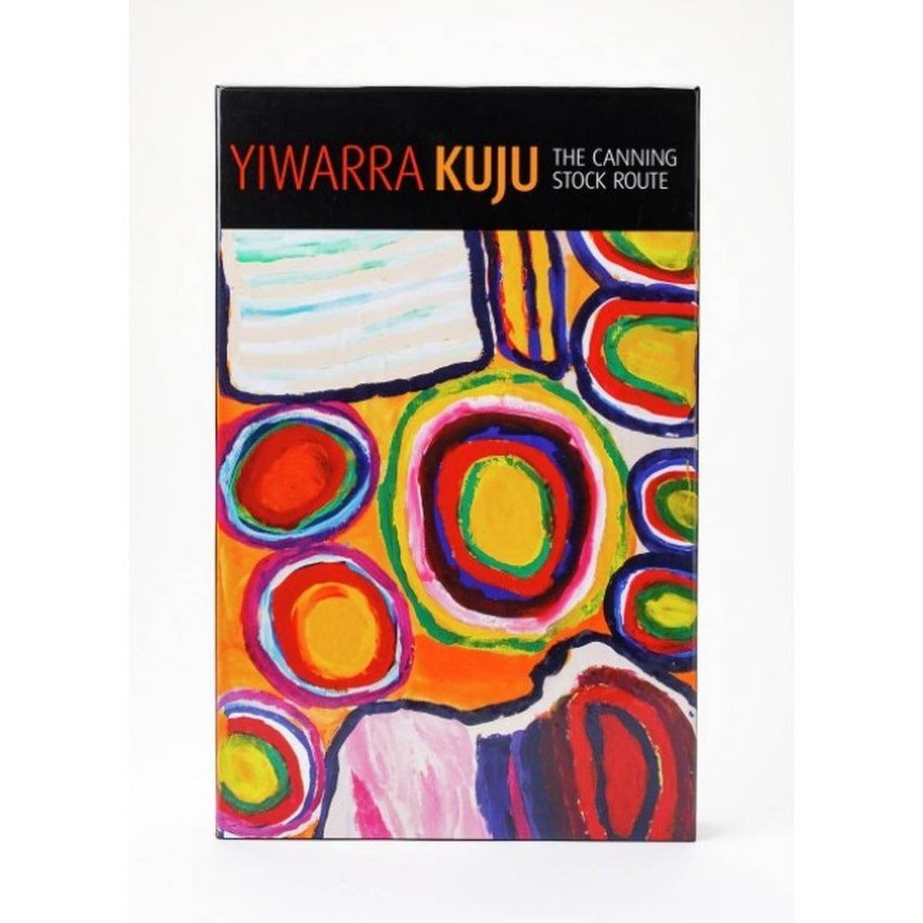 "A puzzle box entitled "" Yiwarra Kuju The Canning Stock Route"" featuring artwork by Dadda Sampson. Bold circles and other shapes in bold contrasting colours"