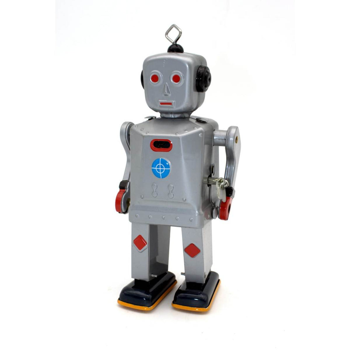 A silver wind up tin toy robot, a reproduction of a vintage Japanese toy . It is mostly silver, with red and blue details and features a square antenna on its head.