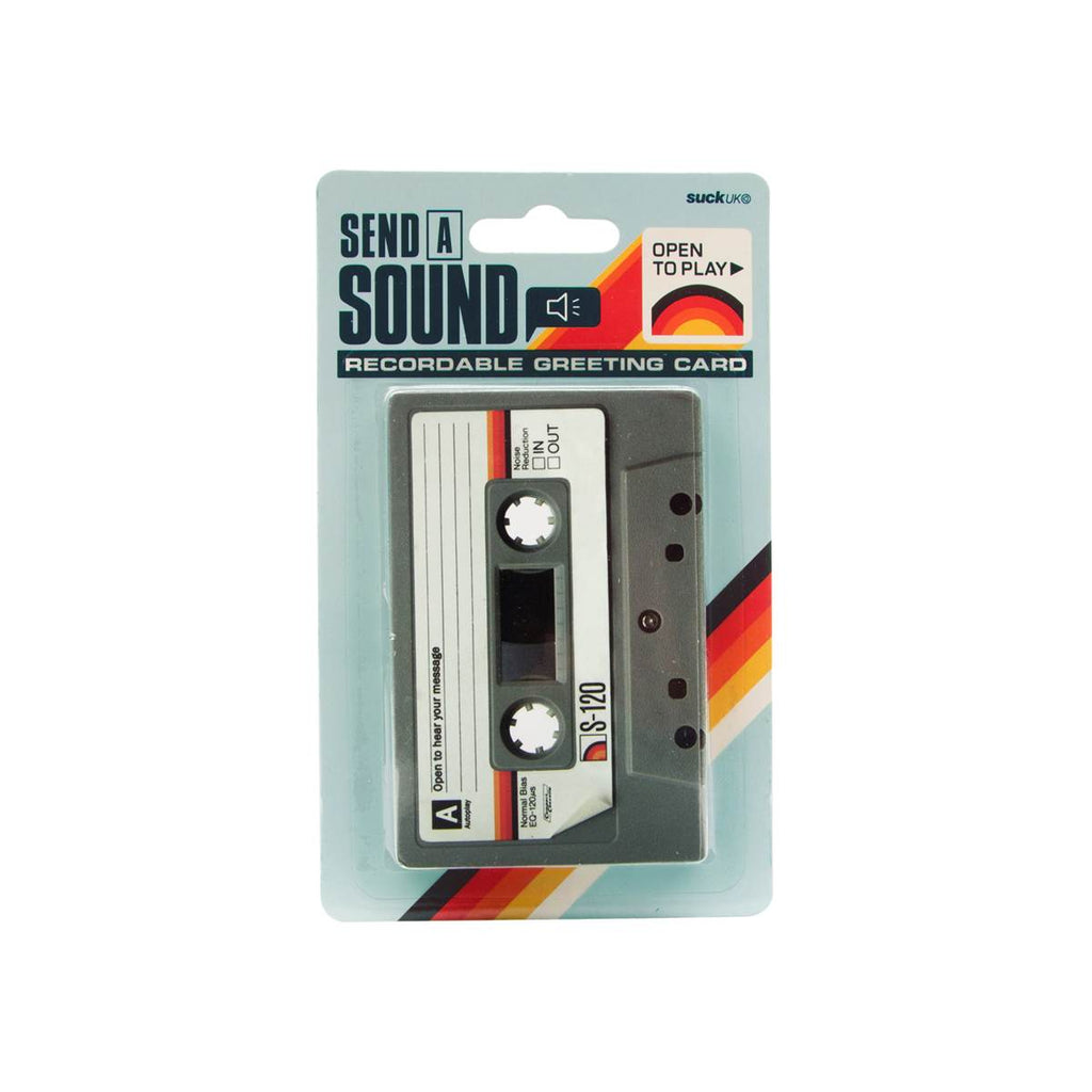 A greeting card in the unusual shape of a cassette tape. Shown in packaging featuring the following text: Recordable greeting card, send a sound, open to play.