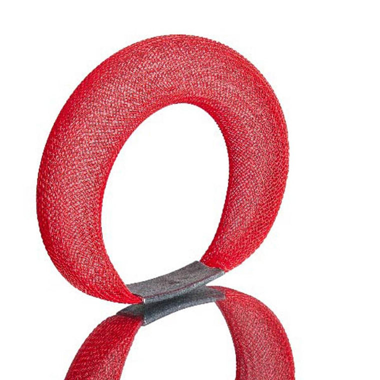 A red bracelet made from finely woven nylon mesh