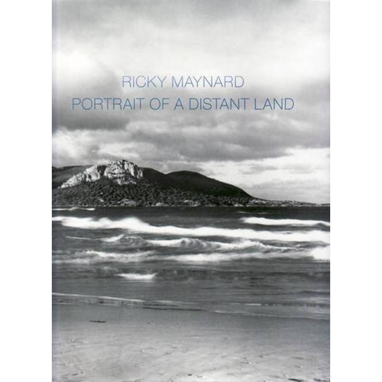 A Catalogure cover featuring a black and white photograph of waves rolling in, in front of a landscape. By Ricky Maynard