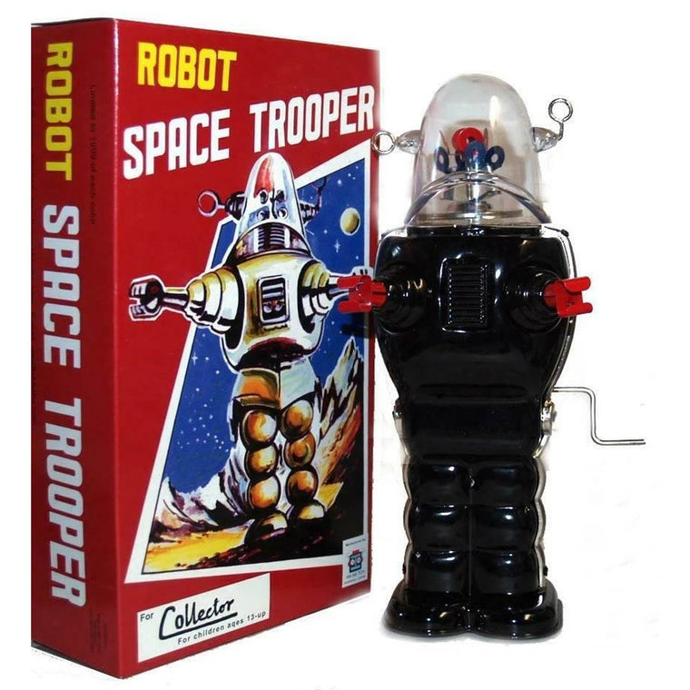 "A large wind up tin toy robot, based on the iconic 1950s "" Robby the Robot Character"". It is mostly black, with reg hands and feet, and a clear dome head with colourful parts inside."