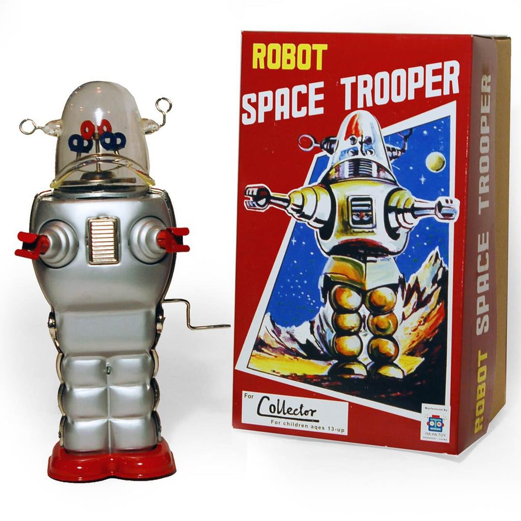 "A large wind up tin toy robot, based on the iconic 1950s "" Robby the Robot Character"". It is mostly silver, with reg hands and feet, and a clear dome head with colourful parts inside."