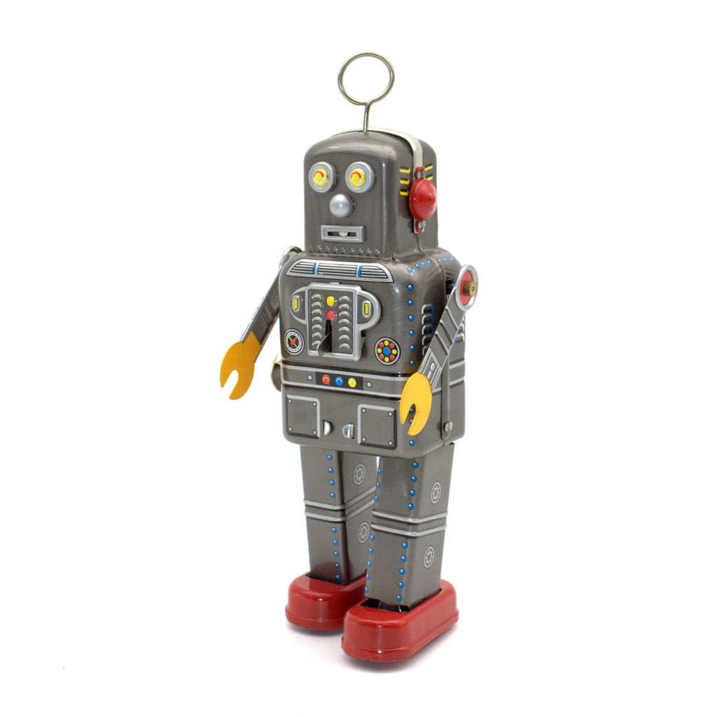 A silver wind up tin toy robot, a reproduction of a vintage Japanese toy . It is mostly silver, with red, blue and yellow details and features a spinning circular antenna on its head.