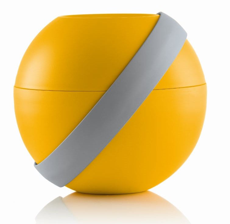 A uniquely designed spherical lunchbox in a bright yellow , with a grey closure strap.