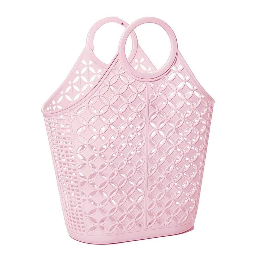 Tote bag in pastel pink featuring an atomic star pattern