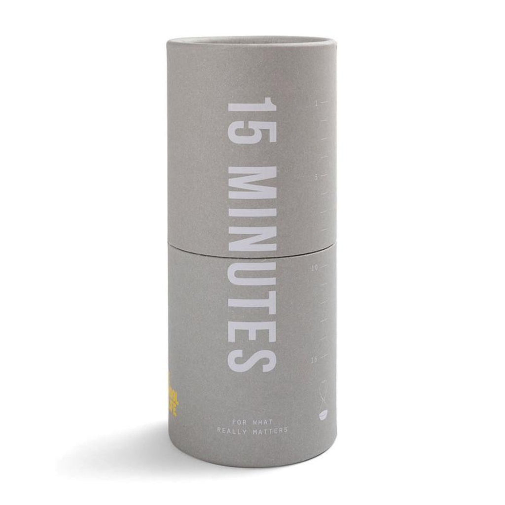 Image featuring a grey tube in the centre which has white text on it in the centre of the product stating 15 minutes - for what really matters