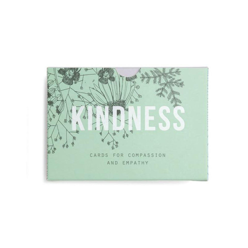 Image featuring a pastel green packaging box with a black thin illustration of flowers in the left corner, with white font in the middle reading the word - Kindness