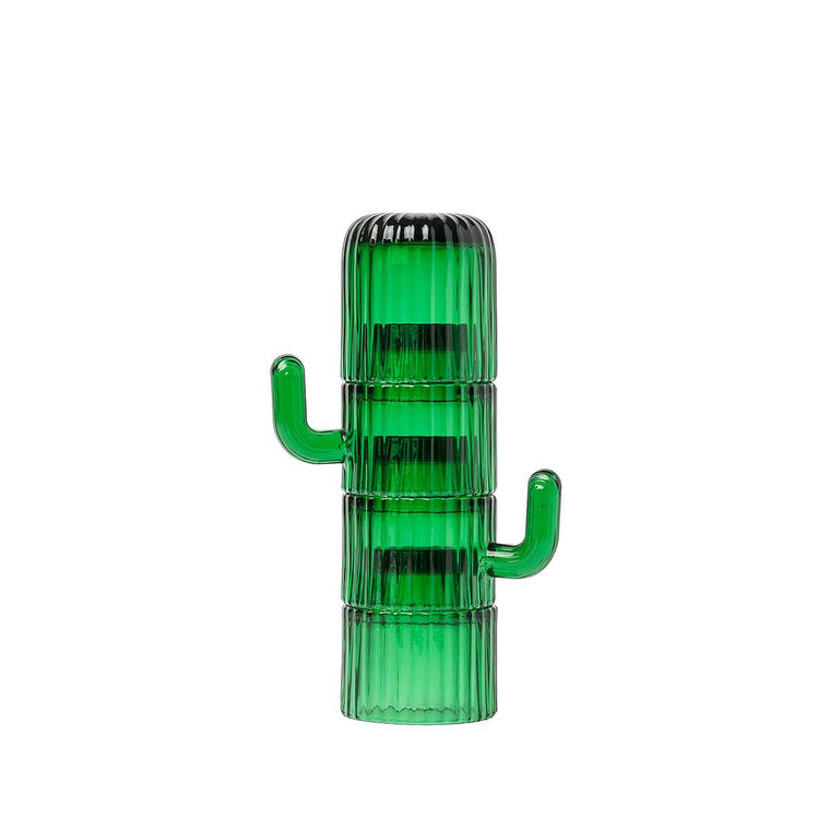 A set of green glass coffee cups.  Featuring green ridged finish in order to imitate a Saguaro Cactus. Shown stacked one on top of the other, the stylised handles of the cups look like the branches of the cactus.