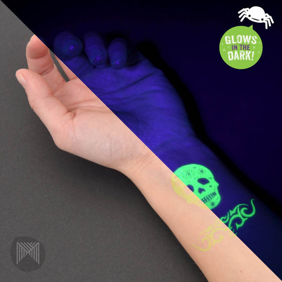 A pack of various glow in the dark skull themed temporary tattoos. The pack contains two sheets each with 12 individual tattoos.