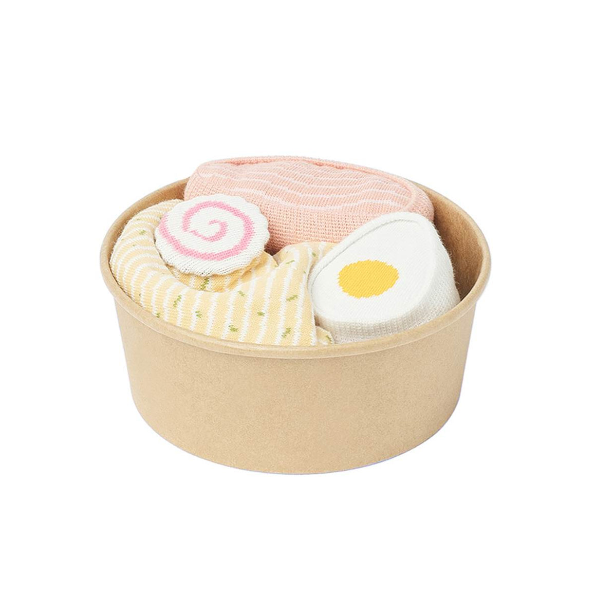 A set of two pairs of sock in multiple prints. Printed, rolled and presented in a cardboard 'bowl' to look like a bowl of Ramen, featuring noodles, egg, pork and a pink spiral radish.