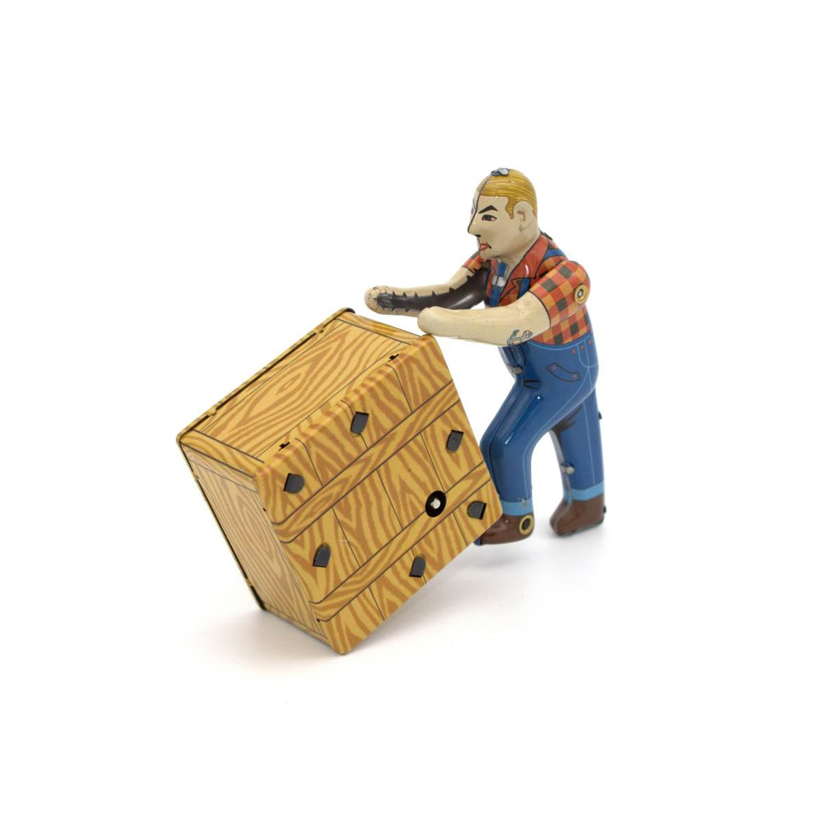 A wind up tin toy featuring a man in workman overalls, pushing a wood grain box