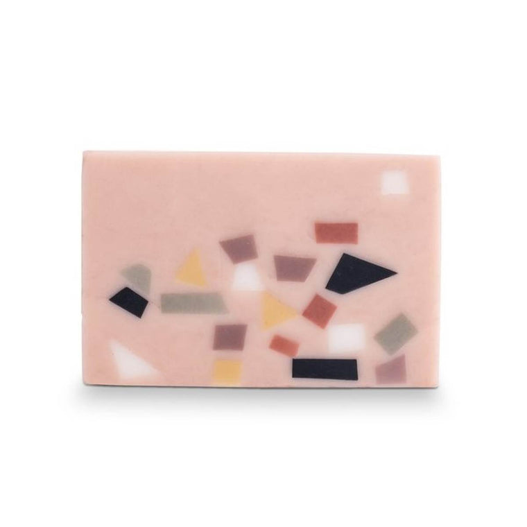 A Pink bar of soap, featuring a terrazzo finish in tones of black, white, pink, yellow and olive green