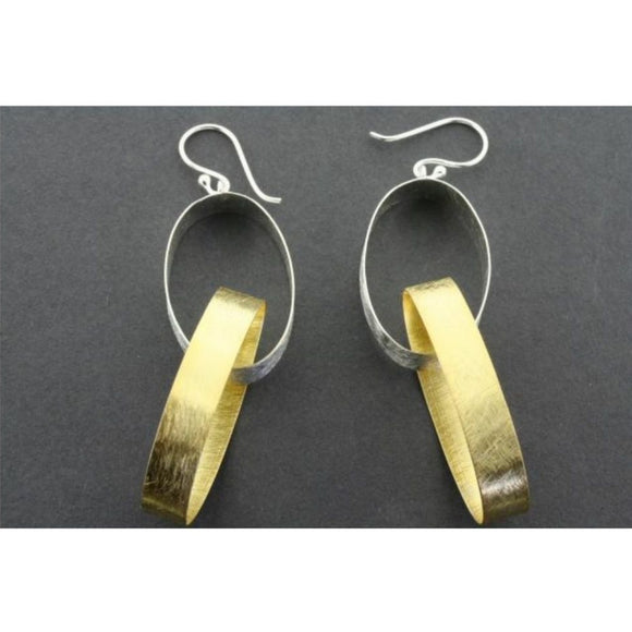 A pair sterling silver and gold two hooped drop earrings sitting on top of a grey background