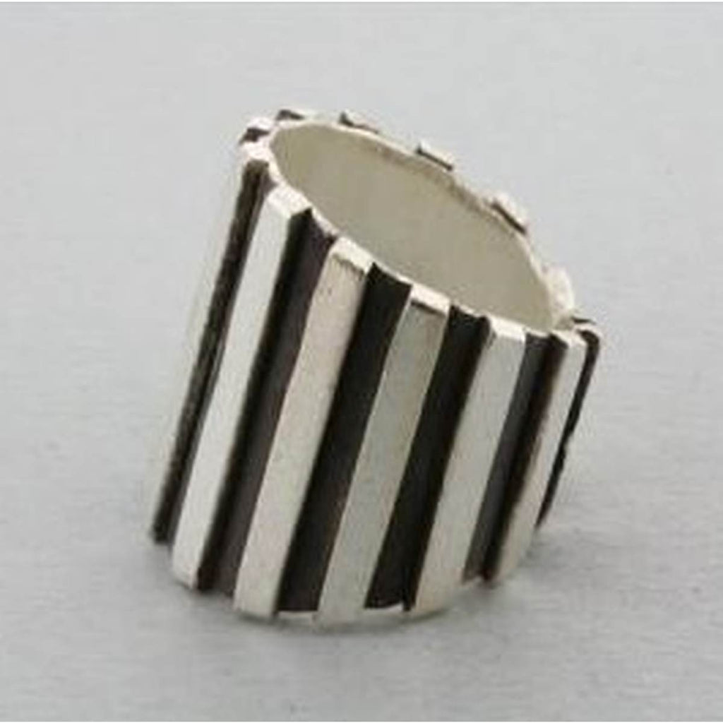 A broad silver Band Style Ring with etched stripes. The depressed surface between the stripes has been oxidised for greater impact.