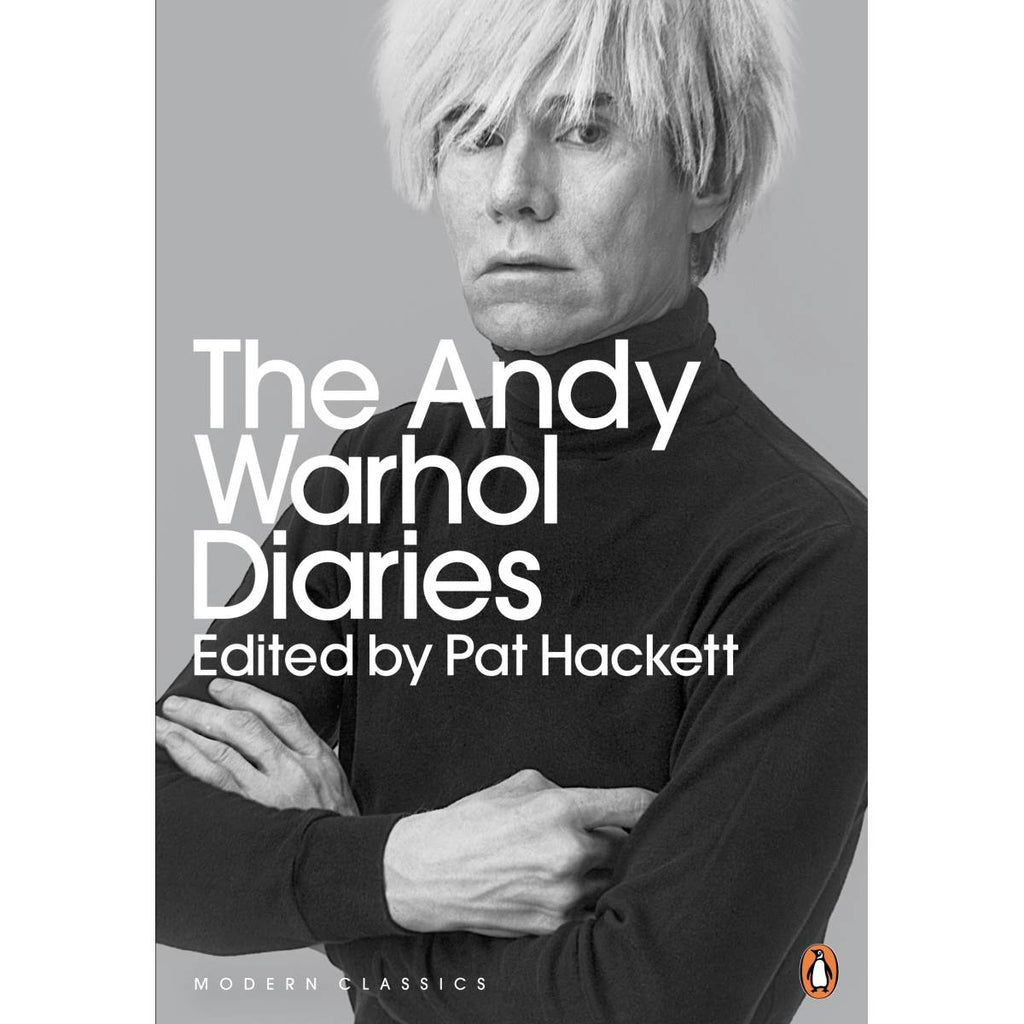 A book cover with a cover photograph of Andy Warhol, posed with his arms crossed.