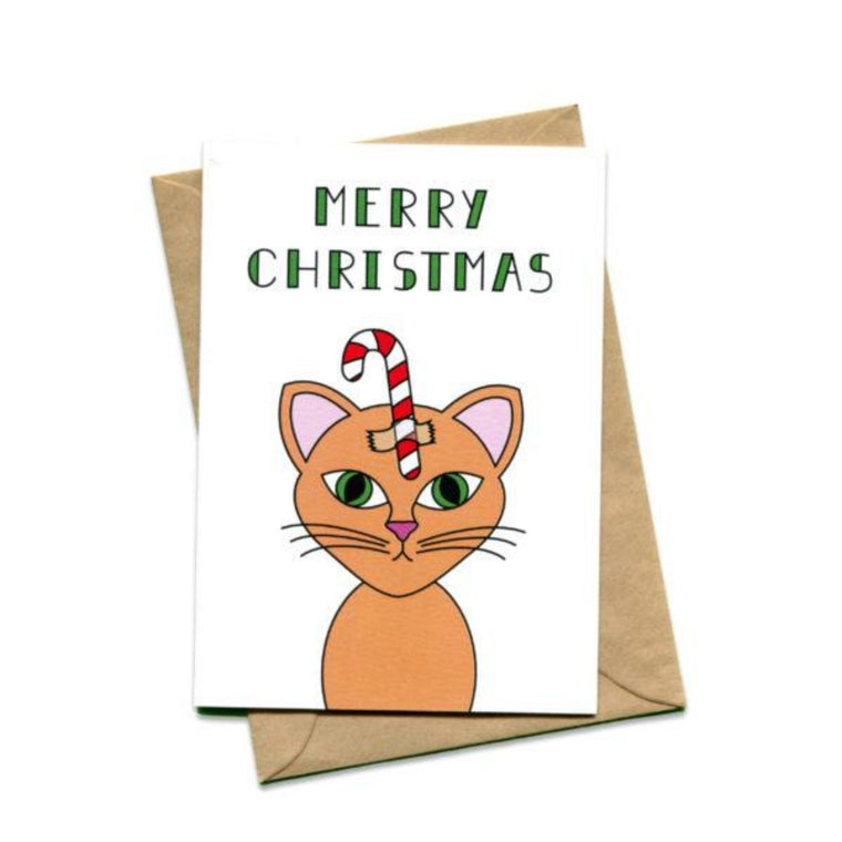 Image featuring a card with green text saying Merry Christmas which also includes a graphic illustration of a tanned cat with a christmas candy cane on their head