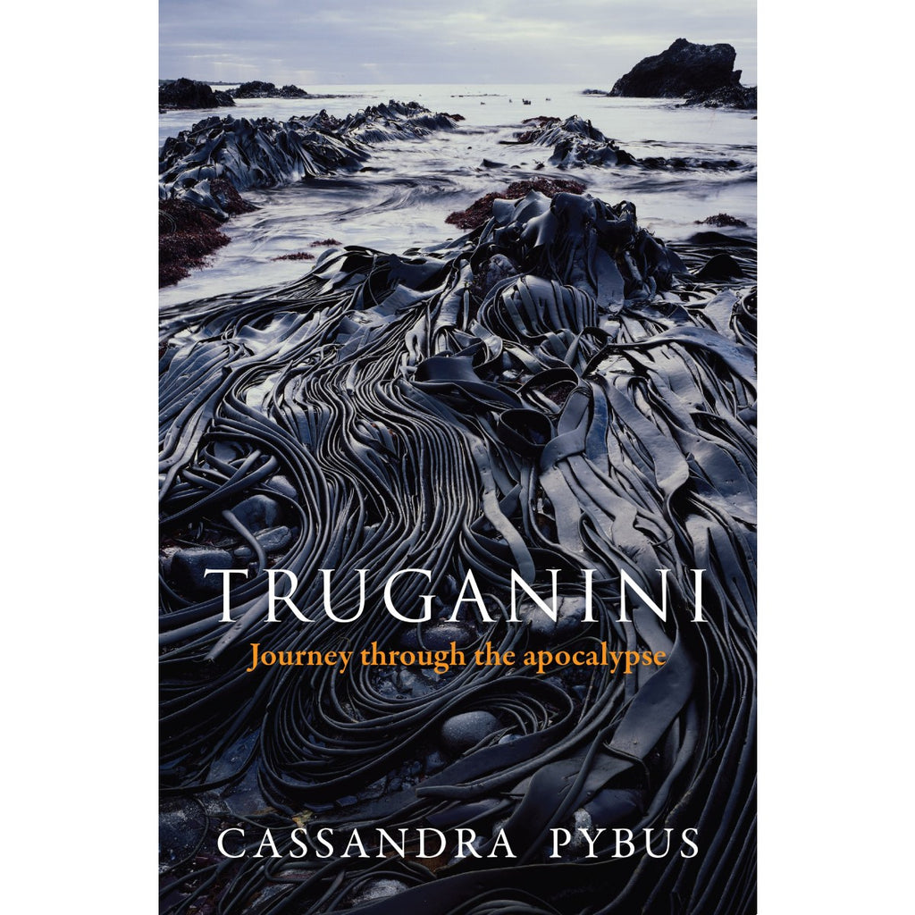 "The book cover for "" Truganini: Journey through the apocalypse"" featuring a photo of a shoreline covered in rich dark black kelp."