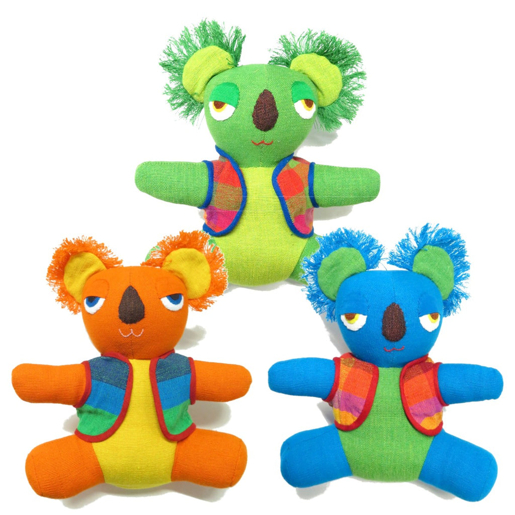a group of three brightly coloured koala soft toys.
