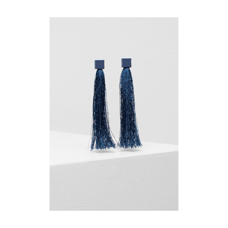 Image featuring a pair of two earrings both in a navy blue colour and including a rubberised metal square on the top and then blue silk tassels underneath