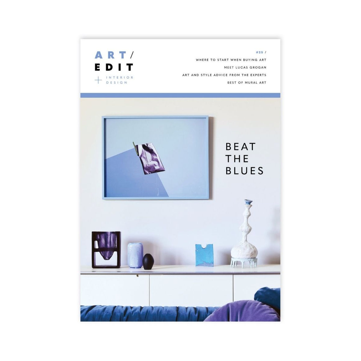 Art Edit Magazine cover featuring a photograph of an interior of a living room which features a blue focused painting surrounded by various blue objects and sculptures