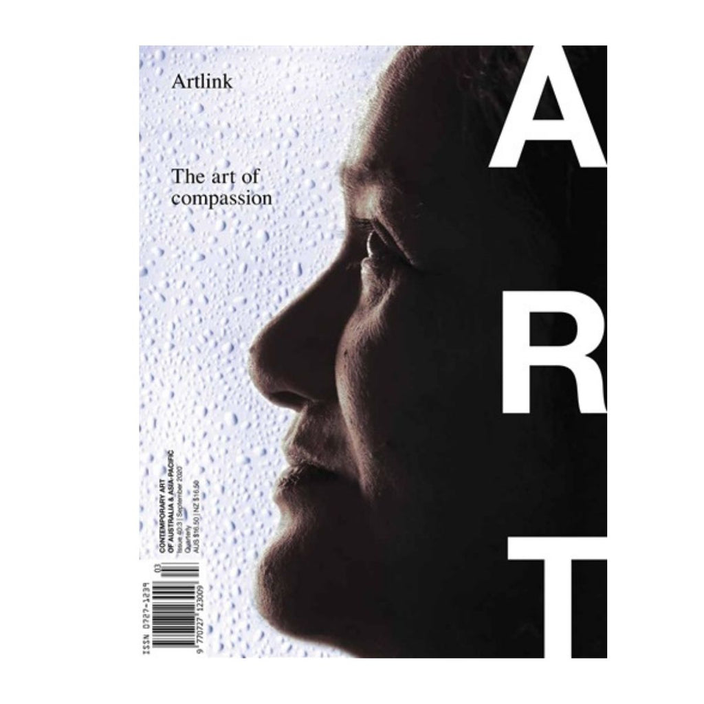 Artlink magazine cover with the text the art of compassion including an image of a human face in front of a textured white wall