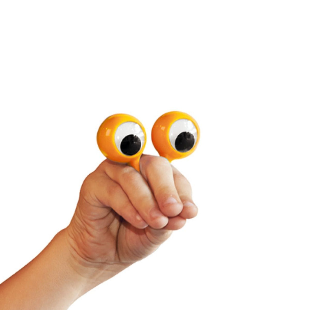 Image featuring a photograph of a hand with an orange eye finger puppet placed on a finger