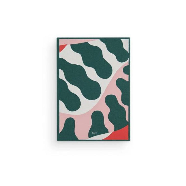 Image featuring the cover of the 2021 family life diary which features abstract shapes that looks slightly like leaves which includes organic colours (green, white, red and pink)