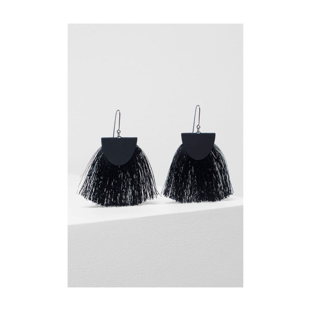 Image featuring a pair of two earrings both in black which includes a rubberised metal half moon shape and black silk tassels falling underneath it