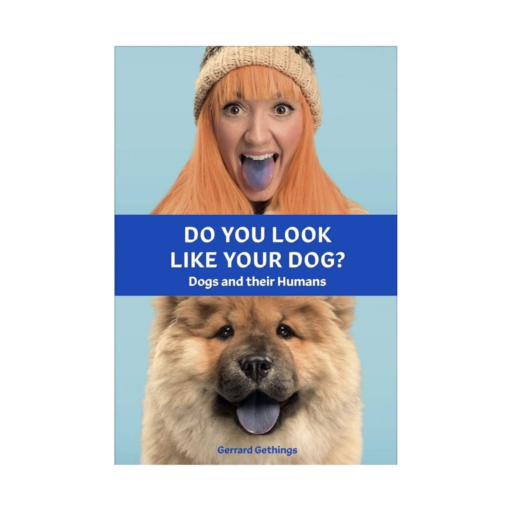 Book cover featuring a blue background with a photograph a woman with orange hair poking out a blue stained tongue with a orange tan furred dog with a similar blue tongue poking out
