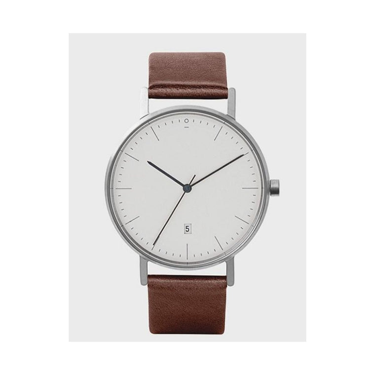 Image featuring a white background with a classically designed watch in the center which includes a Brown leather strap, white face and a silver case