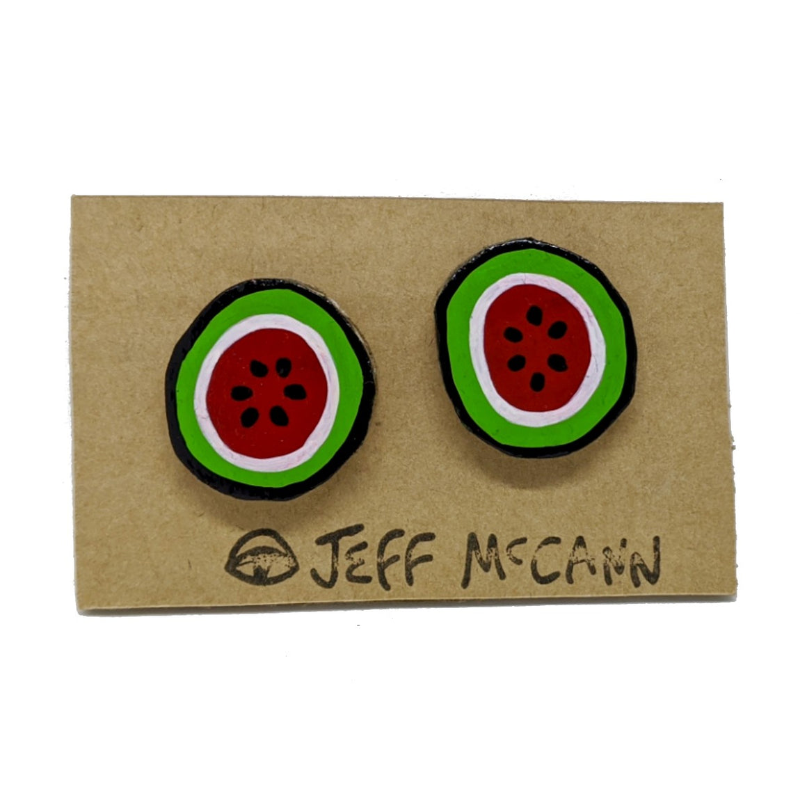 A Pair of stud Earrings made of hand painted cardboard. A design in the shape of a watermelon cut open - in red, green, white and black.