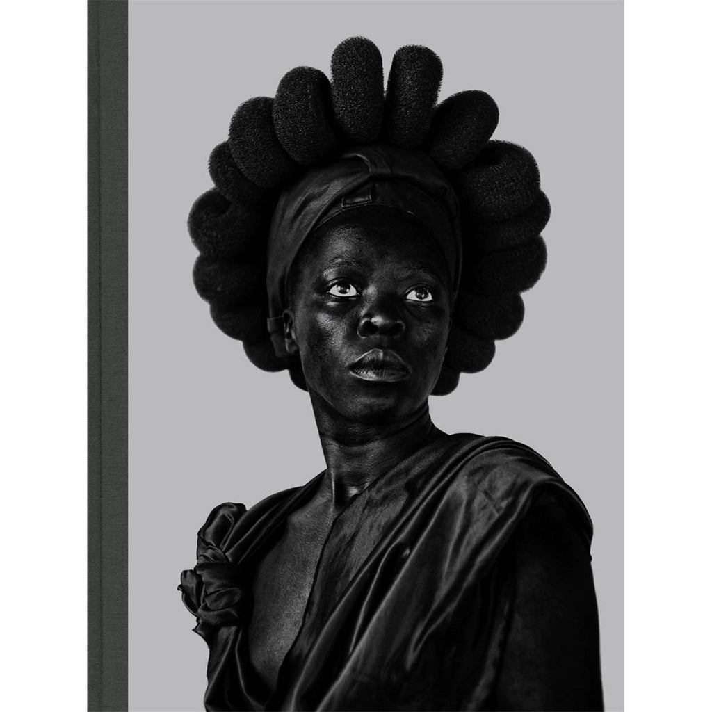 A monochrome rectangular book cover featuring a photographic self portrait by Zanele Muholi.